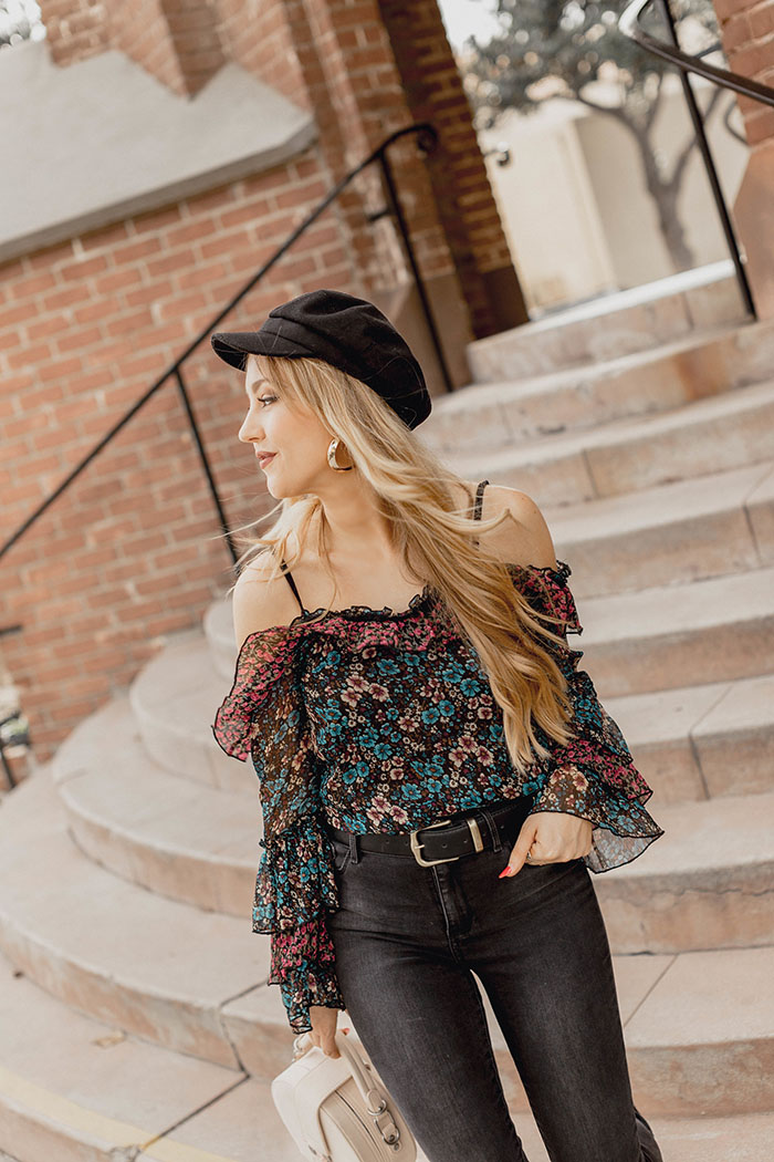 Baker Boy Hat trend, how to style the baker boy hat, vegan baker boy hat, best baker boy hats, river island floral top, off the shoulder floral top, mott & bow jeans, mott & bow skinny jeans, mari a. boots, vegan chelsea boots, veggani ace handbag, Hannah Hagler, Hannah champagne lifestyle, champagne lifestyle, champagne lifestyle blog, fashion blogger, affordable fashion blogger, budget friendly fashion blog, budget friendly fashion blogger, beauty blogger, youtuber, female youtuber, interior designer, affordable fashion, chic fashion ideas, fashion inspiration, vegan fashion, vegan fashion bloggers, vegan fashion, cruelty free fashion, cruelty free, vegan handbag, vegan designer handbag, veggani ace blush pink, round pink vegan handbag, paige printed dress, off the shoulder printed dress, floral dress, public desire pearl sandals, pearl embellished, vegan fashion, sustainable fashion, cruelty-free fashion