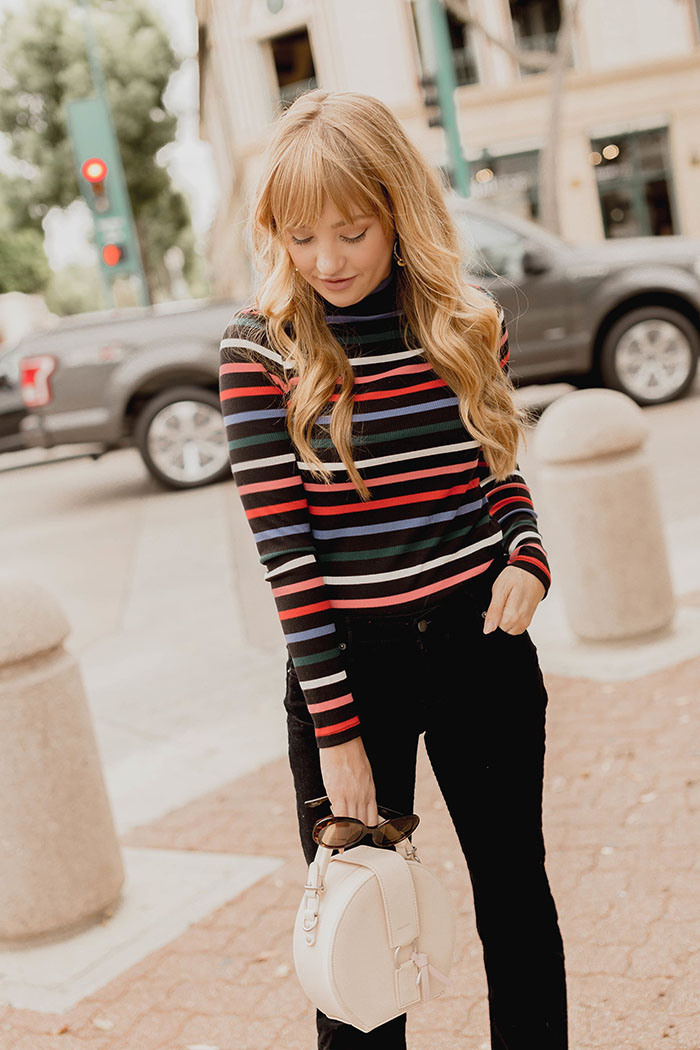 3 fall trends you need, affordable fall fashion trends, fall fashion trends 2017, how to style a striped turtleneck, how to style cropped flares, cropped flare jeans, how to style white booties, old navy, veggani ace handbag, retro tortoise sunglasses, Hannah Hagler, Hannah champagne lifestyle, champagne lifestyle, champagne lifestyle blog, fashion blogger, affordable fashion blogger, budget friendly fashion blog, budget friendly fashion blogger, beauty blogger, youtuber, female youtuber, interior designer, affordable fashion, chic fashion ideas, fashion inspiration, vegan fashion, vegan fashion bloggers, vegan fashion, cruelty free fashion, cruelty free, vegan handbag, vegan designer handbag, veggani ace blush pink, round pink vegan handbag, paige printed dress, off the shoulder printed dress, floral dress, public desire pearl sandals, pearl embellished, vegan fashion, sustainable fashion, cruelty-free fashion
